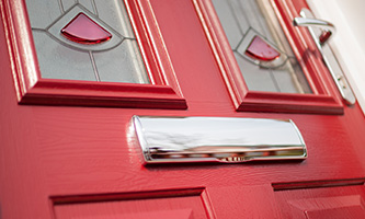 red door with letter box
