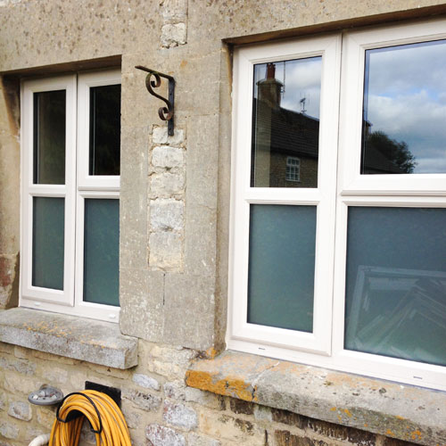 UPVC white windows on stone building